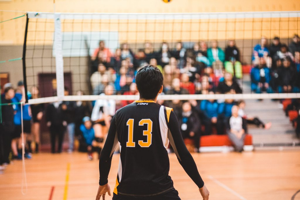 man wearing black 13 volleyball jersey